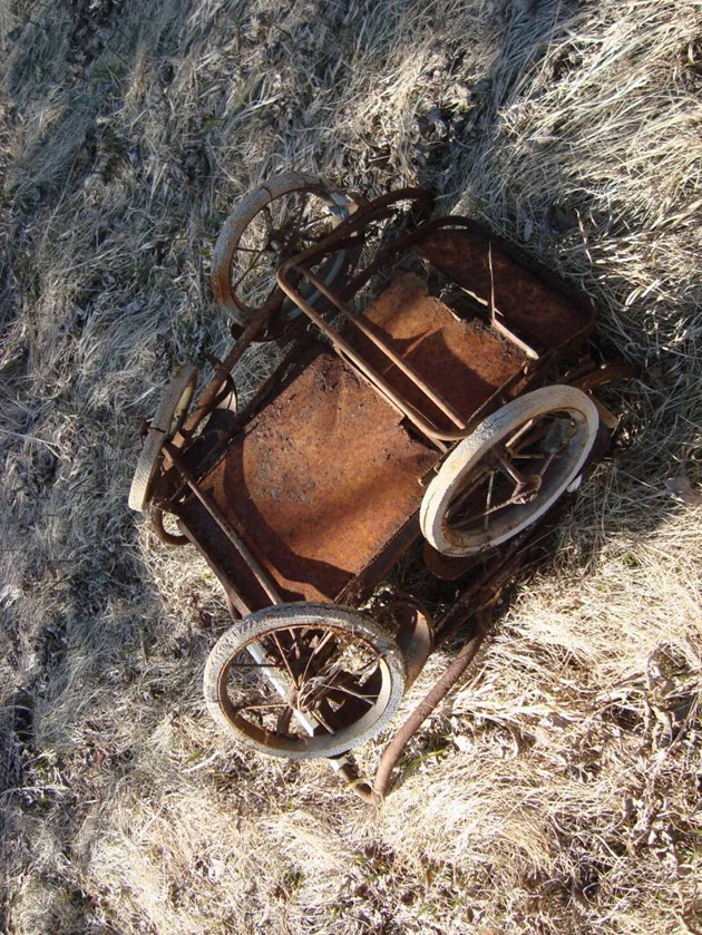rusted baby stroller